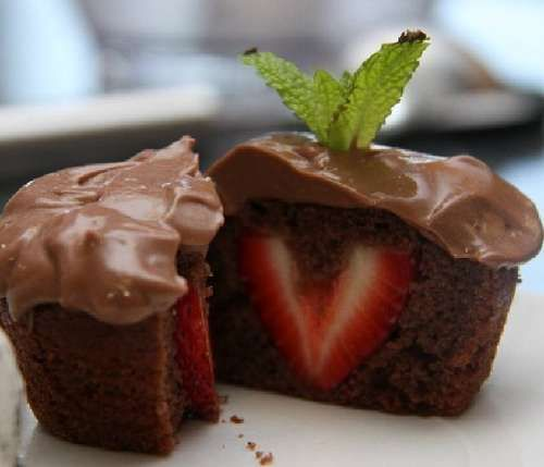 Sweetheart Cupcakes: Chocolate Pudding Cupcakes with Strawberry Centers! I can use my surprise pan!