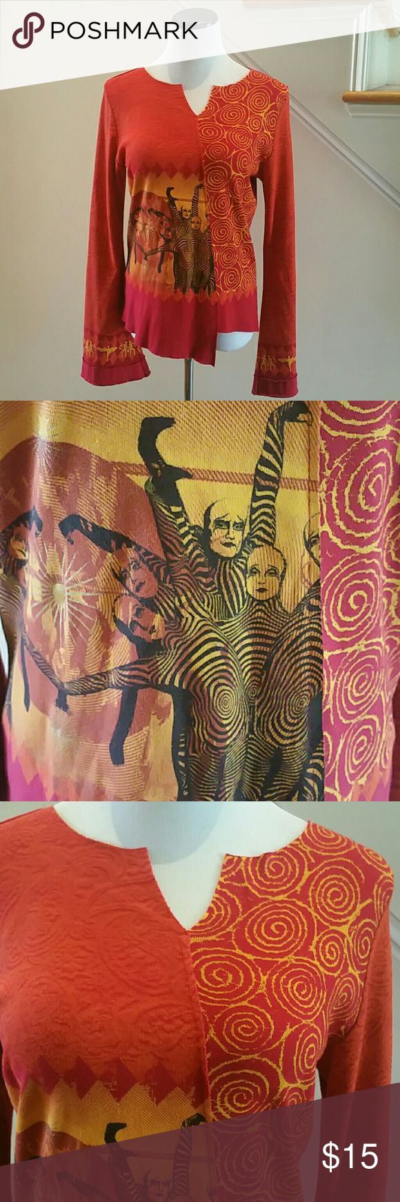 "Top - ""Cirque Du Soleil"" Authentic If you're a fan or have a lasting impression of a performance, this fun and unique top will be great to have as a stylish fashion item or memorabilia. Bright orange with a theatrical design to include performers. Made in Canada. Gentle wear and I'm very good condition. C: 38"",  L: 25"" & 23"" in front - two cuts, Bell sleeves: 27"" Tops"