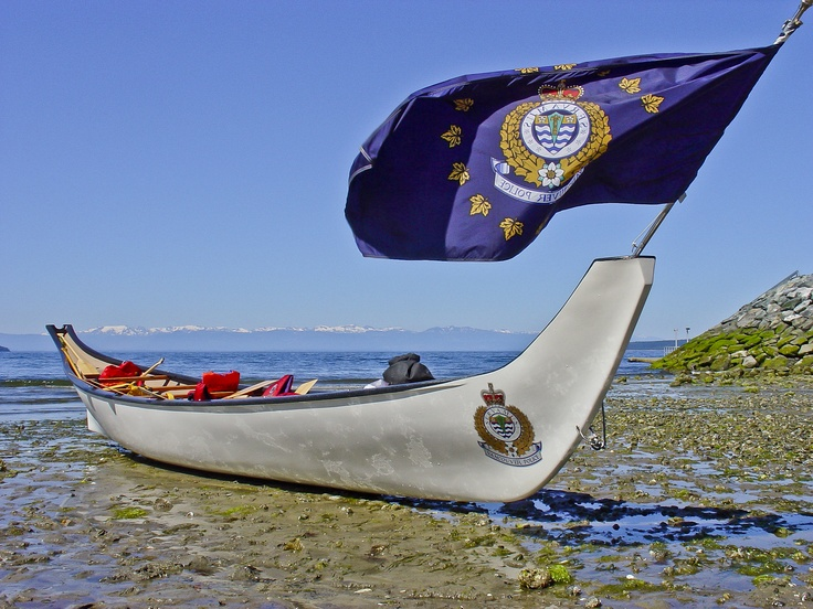 """Every Spring, in Coast Salish tradition, the Vancouver Police Department """"wakes up"""" the VPD canoe in preparation for the Pulling Together Canoe Journey during the summer.    The canoe is named NCH'7MUT, pronounced """"In-CHOTE-Mote,"""" which means """"One Heart, One Mind."""""""