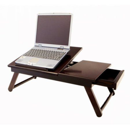 Folding Wooden Laptop Drawer Desk Portable Table Reading Desk.Complete your work in the comfort of a bed or sofa with this Folding Wooden Laptop Drawer Desk Portable Table Reading Desk.This item features a foldable design and a drawer for added convenience. It allows you to adjust the angle and store necessities in one place, so you always have everything you need. The lap desk with drawer is made from a wooden material.