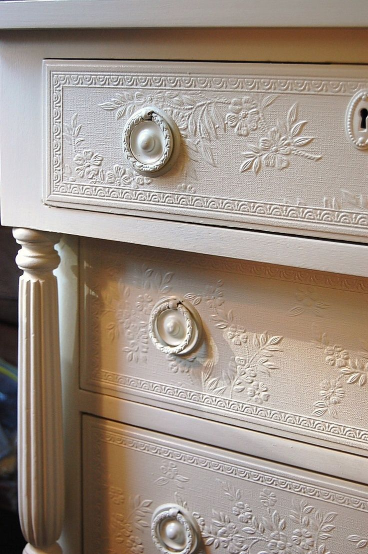 how clever. They just put embossed wallpaper on the drawer fronts to give it a new texture and make it look very chic