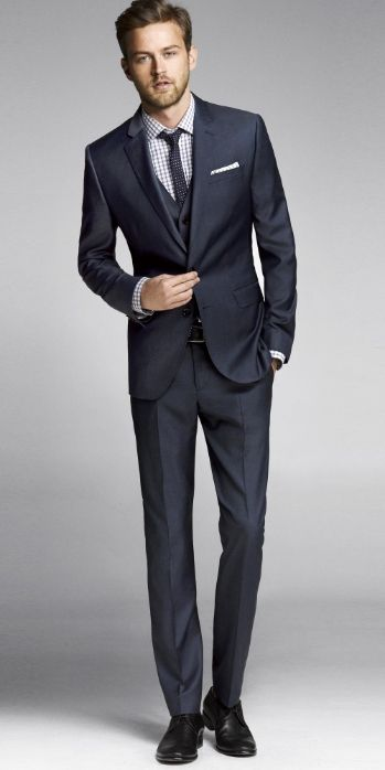 Contemporary twist on traditional suit.  Narrow proportions and clean lines.  Navy Twill Photographer Suit, Express Men.