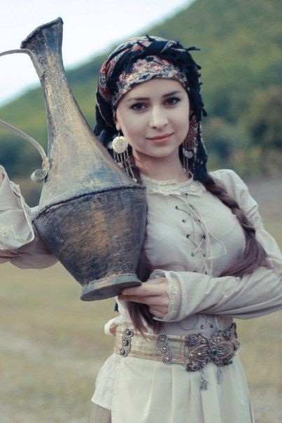"""Crimean Tatar girl with traditional costume and """"gugüm"""" The tatars are a turkic…"""