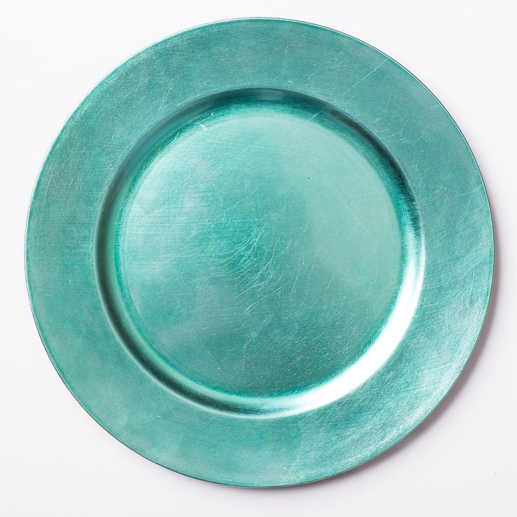 Accent banquet tables with our stylish charger plates for weddings, parties, and events.  Plate chargers offer a decorative flair to event tablescapes, adding an elegant metallic shine to table designs. A 13 in. Turquoise Charger Plate acts as a dressy base for dinner plates, and is intended for decor purposes only--do not place food directly on plate charger.   Love the metallic look of our charger plates? Try complimenting turquoise wedding charger plates with turquoise acrylic napkin…