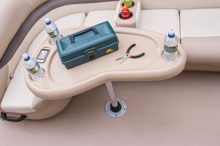 Removable table w/moulded-in drink holders http://www.exclusiveautomarine.com/product/fishin-barge-20-dlx