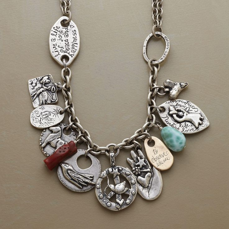 GRATITUDE NECKLACE -- Two rarities join Jes MaHarry's sterling silver and 14kt gold expressions of joy, love, peace and happiness: a branch of Tibetan coral and a larimar nugget. Double sterling silver chain