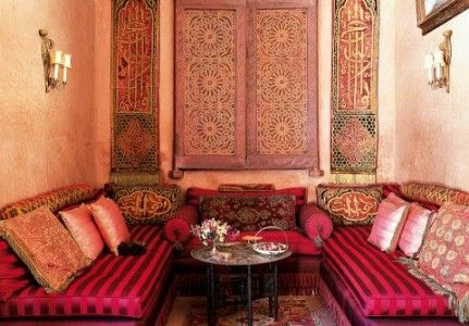 Moroccan Elements: Large floor tiles are painted in hues of terra cotta, like the walls. The most important Moroccan decor is carved wood, both doors, furniture and accessories - each and all works of art. Look out for lovely original accessories  in stores, such as rugs, lamps, lanterns, wall fabrics, embroidered cushions and throws, large curtains, mirrors and knick-knacks.