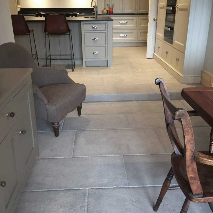 Antiqued grey barr limestone - These beautiful grey stone floor tiles are made completely unique by the traditional hand-tool techniques used to finish them