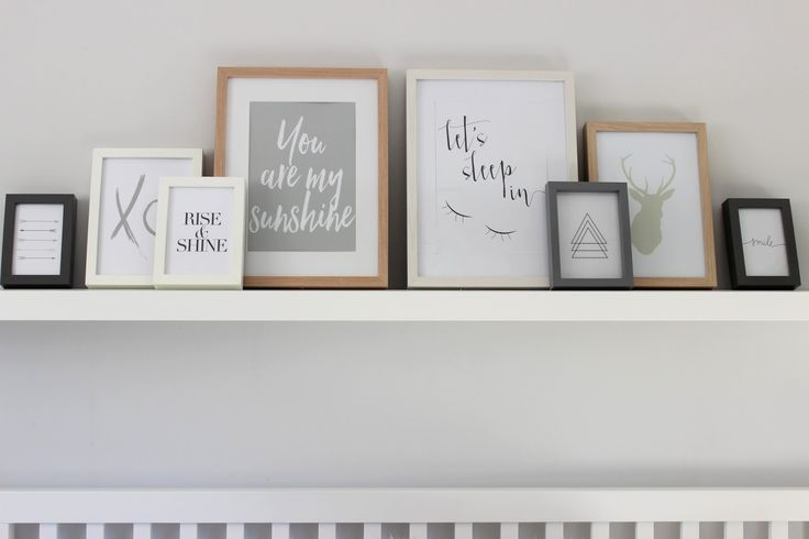 Prints Frames on Shelf over bed bedroom inspiration minimal grey white scandinavian style typography bedroom interior styling inspo