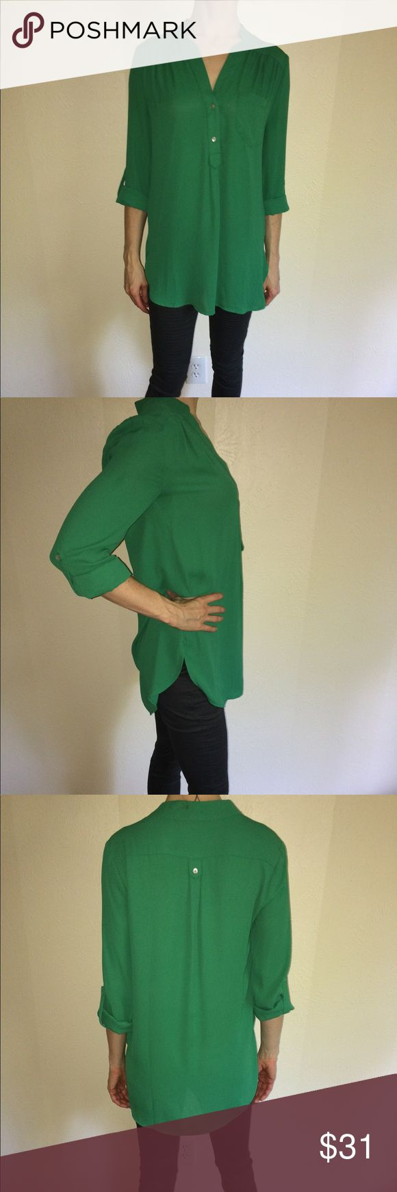 ModCloth Pam Breeze-ly Long Sleeve Tunic in green This vibrant green tunic is adorable loose over skinny jeans/leggings or tucked into a pencil skirt for a blousy effect. Or throw on a cute belt to flatter the waist! Sleeves can be worn long or rolled high for a more casual look. 100% Polyester. Hand wash. Front button closure. Button closure at sleeve cuff. Chest pocket. Interesting cut detail at neck flatters collarbones. Decorative tab at back with button. Perfect condition; worn once…