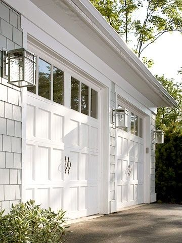 Clopay Reserve Collection wood garage doors painted white rom Midwest Living 2006 Idea Home in Egg Harbor Wisconsin. Light fixtures echo shape of the door ... & 151 best Garage doors images on Pinterest   Front doors Garage ... Pezcame.Com