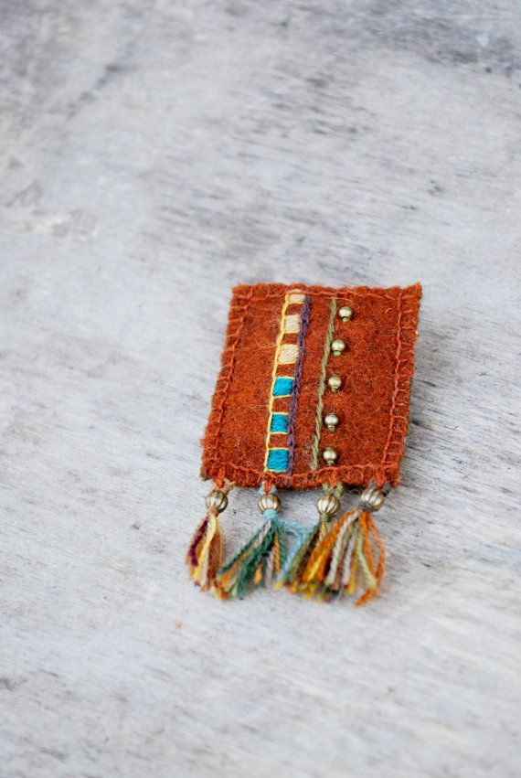 Ethnic woolen textile brooch with embroidery. Rustic orange brooch with colorful embroidery and tassels. Eco friendly.