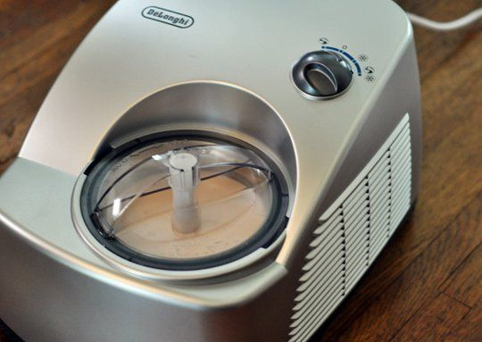 Product Review: DeLonghi Gelato Maker   The Kitchn.  Freezes faster than the Cuisinart compressor machine.  The paddles actually scrape the sides too.
