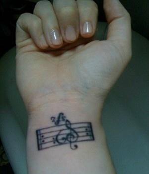 music staff tattoo on wrist