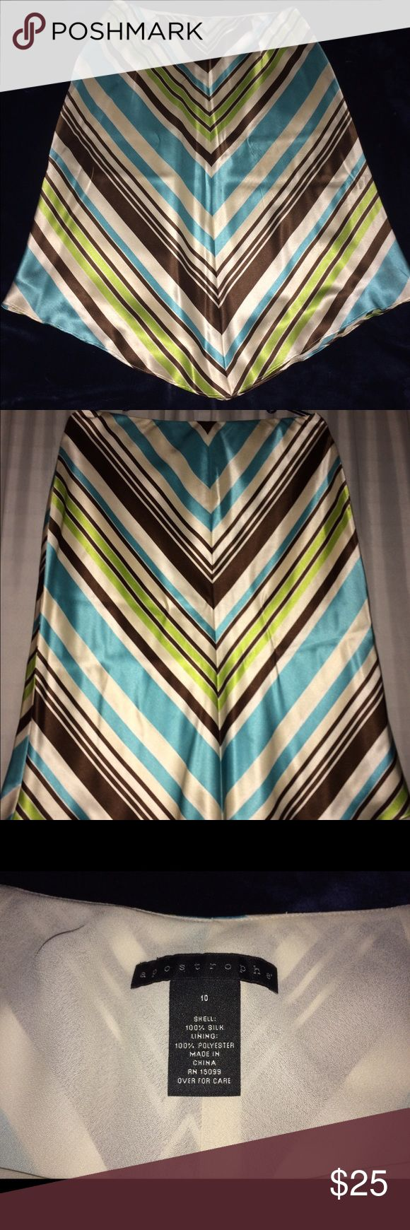 Apostrophe 100% Pure Silk Classy Dress Skirt Apostrophe 100% Pure Silk Classy Dress Skirt, very soft and silky, and in excellent condition. Combination of Brown, Blue, White and Green Colors. Aeropostale Skirts Asymmetrical