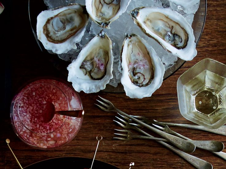 Raw Oysters with Cava Mignonette | This simple mignonette gets great flavor from sparkling wine. Get the recipe from Food & Wine.