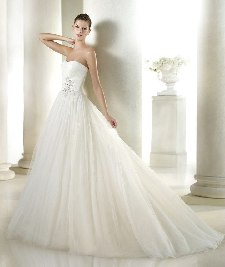 If you're looking for va-va-voom, go for a fuller skirt like this gorgeous number from the San Patrick 2015 Bridal Collection