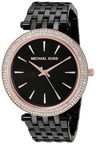Slim markers accent the round dial of this #Michael Kors watch, and a crystal-encrusted bezel creates a luxe look. Link band. Hinged-snap clasp.