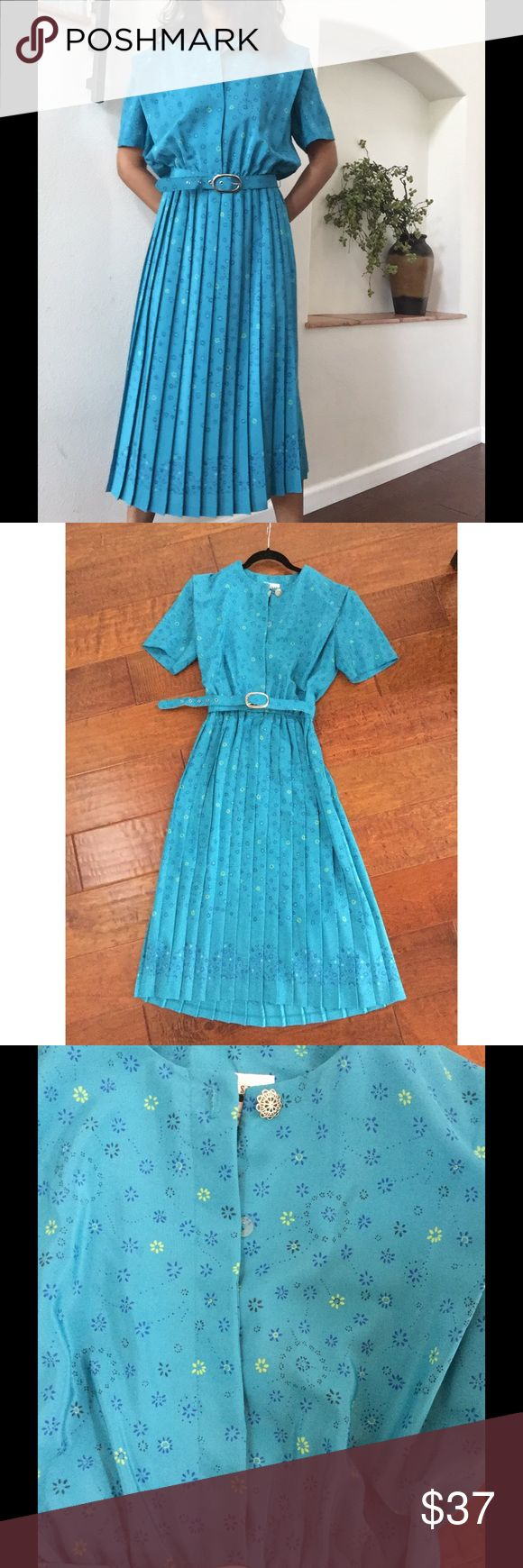 "Leslie Fay Vintage Teal, pleaded Dress This dress is an amazing shade if Teal/ turquoise. Adorable flower print. Pleats. Belt. 3 hidden buttons a the top and 1 silver button. Polyester.Measures- shoulders-18"". Sleeves- 9"". Bust- 40"" max. Waist-24-28"". Length-46"". Vintage Dresses"