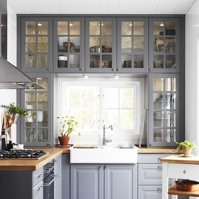 10 Questions to Ask Before Renovating a Small Kitchen. Cabinets around the window, different idea.