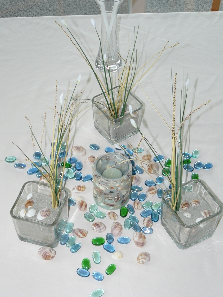 Beach wedding table decorations ~ you could use sea glass instead