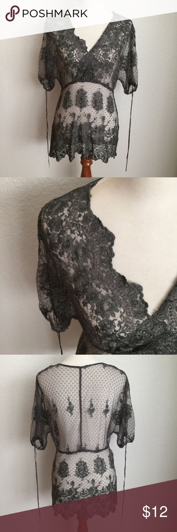 Karen Kane Romantic Lace Top Beautiful grey lace top from Karen Kane. Wear this over any colored cami for a romantic look and feel. Karen Kane Tops Blouses