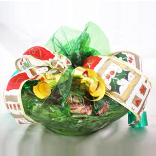 Christmas cake gift basket,  12 wrapped pieces of Christmas cake with almond paste in a cellophane wrapped basket with decorative ribbon.  Divine  Price: Rs.   1800.00