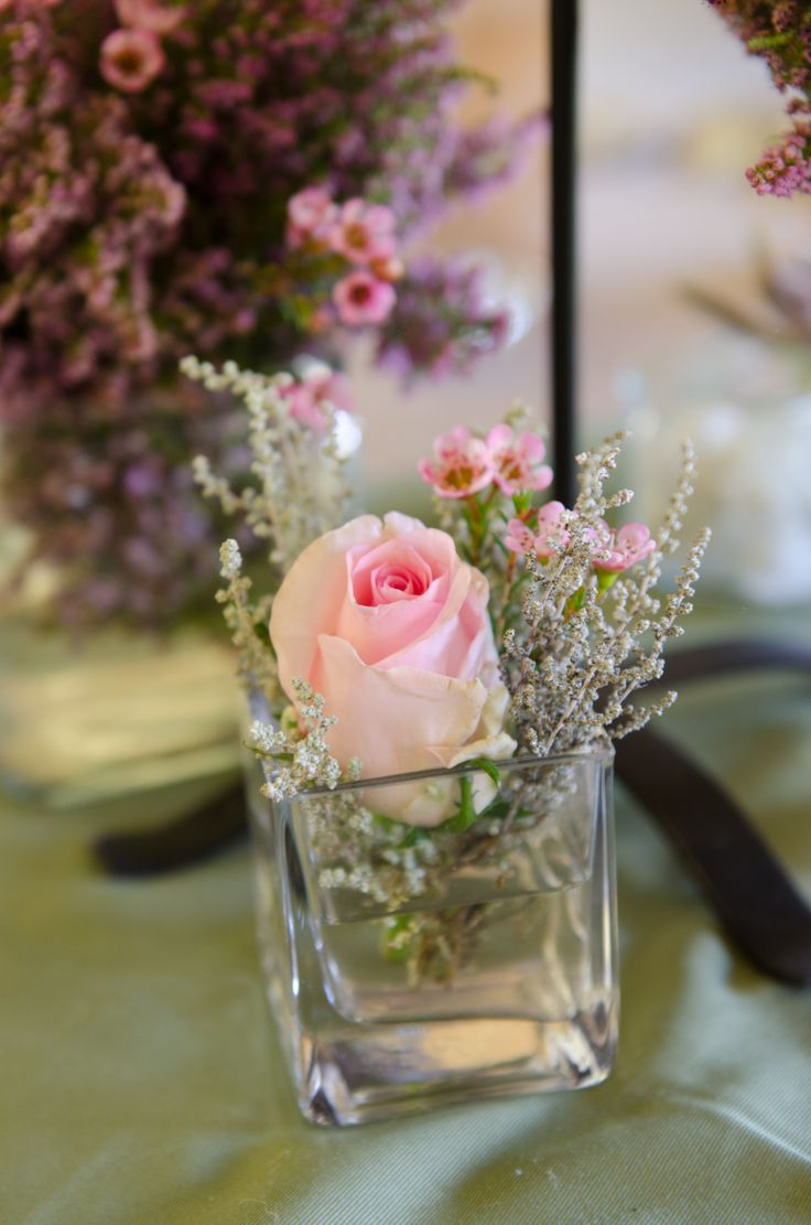 Little posies in a glass cube making up table decor
