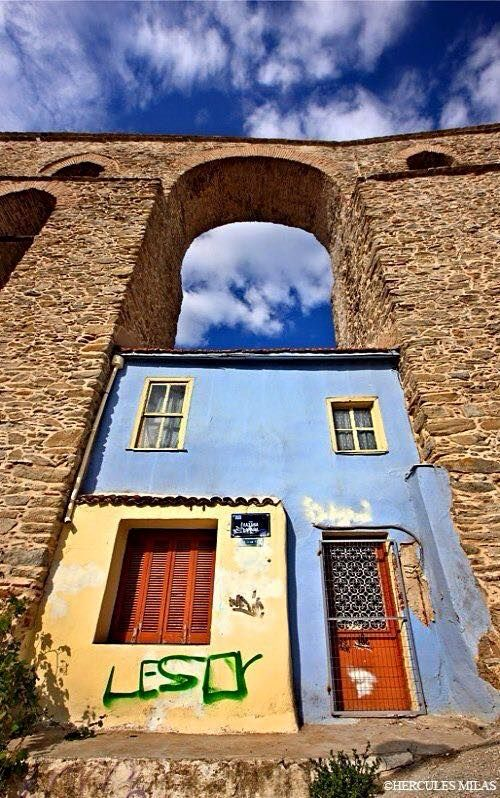 "Beautiful little house under the ""protection"" of the ""Kamares"" (arches), the famous aqueduct of Kavala, #Greece"