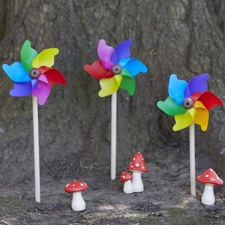 Look what's under the tree - it's a magical whirly fairy garden using Mini Rainbow windmills.........approved for children 18+ months. #whirlywindmills #rainbow #party #fairy #garden #mushrooms