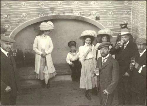 Tsar Nicholas ll of Russia with Grand Duchesses Olga,Tatiana and Maria Nikolaevna Romanova of Russia.Also in the photo is Dr Botkin.A♥W