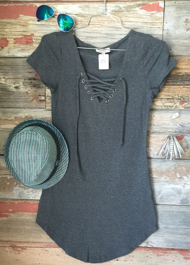The Fun in the Sun Tie Dress in Charcoal is comfy, fitted, and oh so fabulous! A great basic that can be dressed up or down! We love the added detail of the tie front! Sizing: Small: 0-3 Medium: 5-7 L