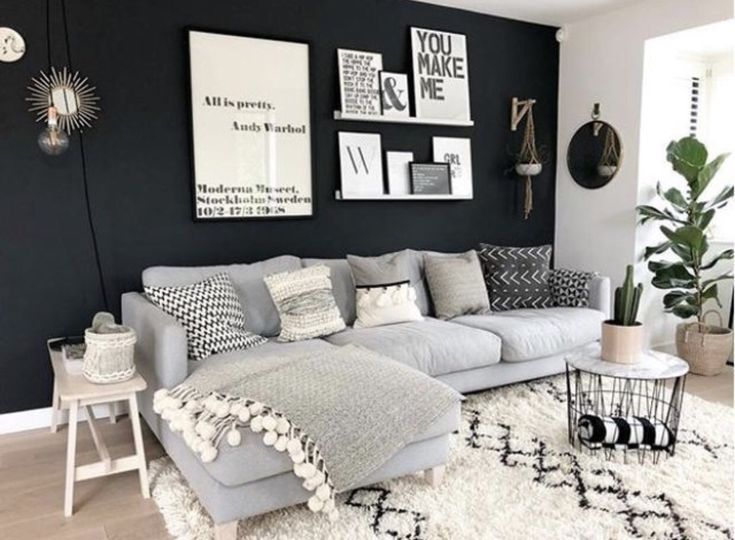 Love the dark wall. Gray couch ❤