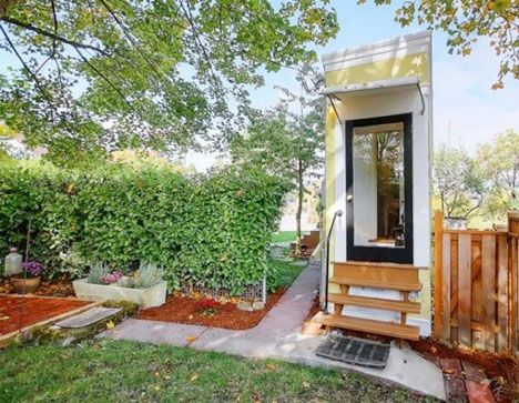 The Montlake Spite House measures just 55 inches across its narrowest point, requiring inhabitants to step to one side to open the oven door when cooking.
