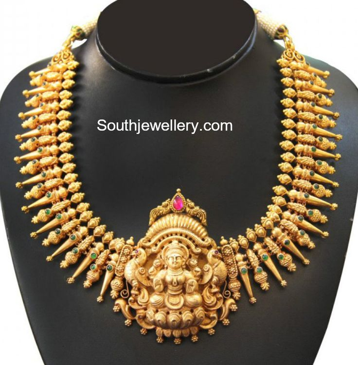 22 carat gold medium length traditional gold necklace with Goddess Lakshmi pendant studded with rubies and emeralds by Amarsons Pearls