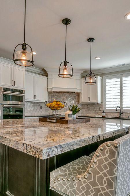 island pendant lightng, white persa granite, fabric Ballard counter stools, two tone cabinets