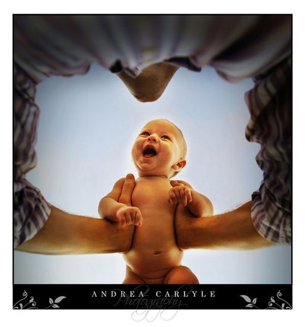 Capturing a babys joy in Daddys arms love this shot from below
