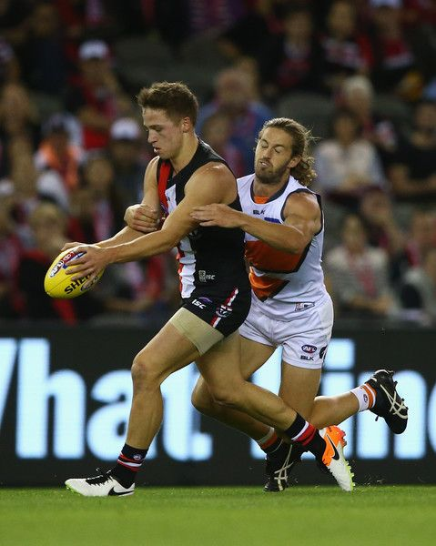Callan Ward Photos Photos - Jack Billings of the Saints is challenged by Callan Ward of the Giants during the round five AFL match between the St Kilda Saints and the Greater Western Sydney Giants at Etihad Stadium on April 24, 2016 in Melbourne, Australia. - AFL Rd 5 - St Kilda v GWS