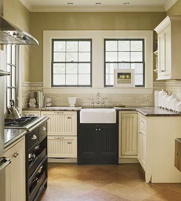 Gorgeous kitchen - love the contrast of the cream cabinets and dark countertops