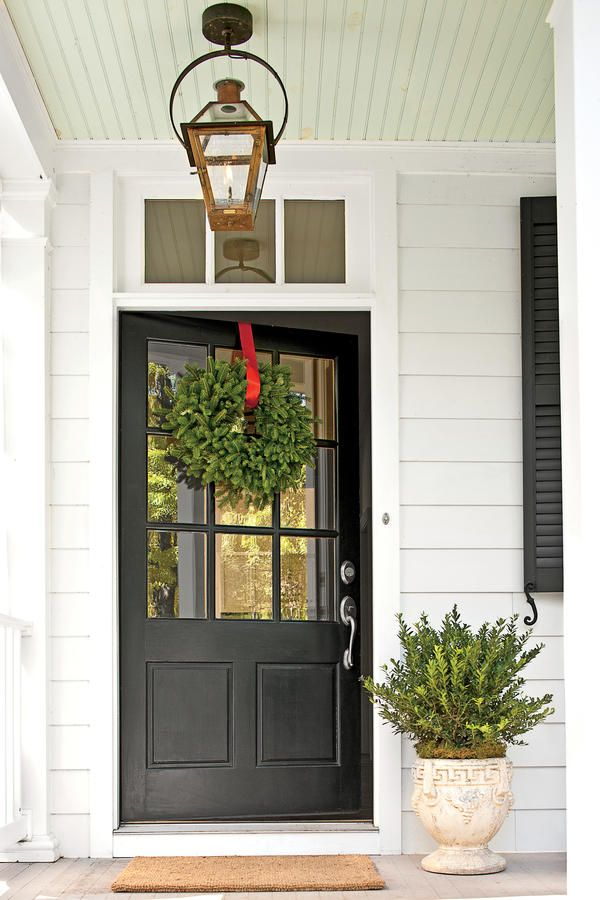 Farmhouse Detail: Oversize Front Door - Charming Virginia Farmhouse - Southernliving. The door's width is greater than usual—42 inches as opposed to 36 inches—to give it more weight and importance. The glass panes invite the outdoors in.