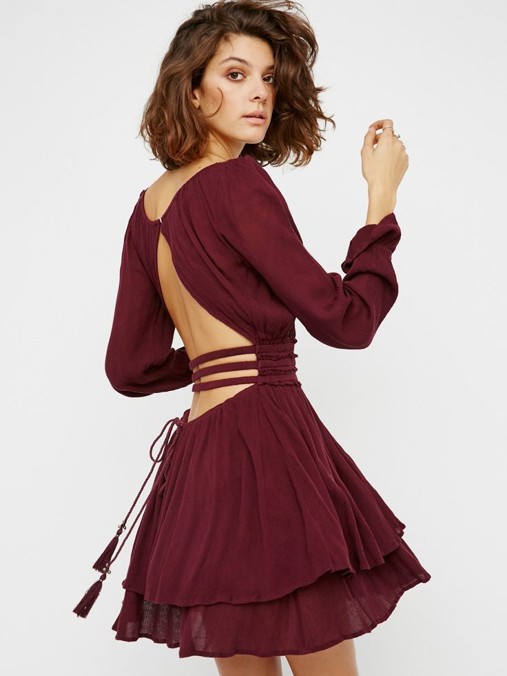 Much Ado Mini Dress | Flowy and crinkly mini dress with a low scoop neckline and a dramatic open back featuring elastic strappy bands. Button closure at back neck for an easy fit and long sleeves with a flared cuff. Raw edges along the elastic and stretchy waist.