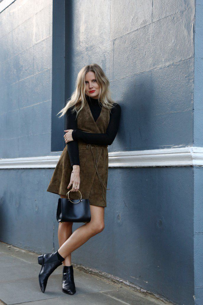 Dare to wear a suede dress like this one worn by Lucy Williams with a pair of black ankle boots and a cute miniature bag. Top: Topshop, Dress: Asos, Bag: Future Glory.