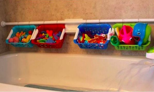 Use a shower rod and small plastic baskets to make the perfect way to store your kid's bath toys. | 100 Genius Hacks Guaranteed To Make A Parent's Job Easier