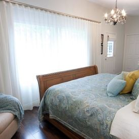 ripple fold pleated curtains in bedroom
