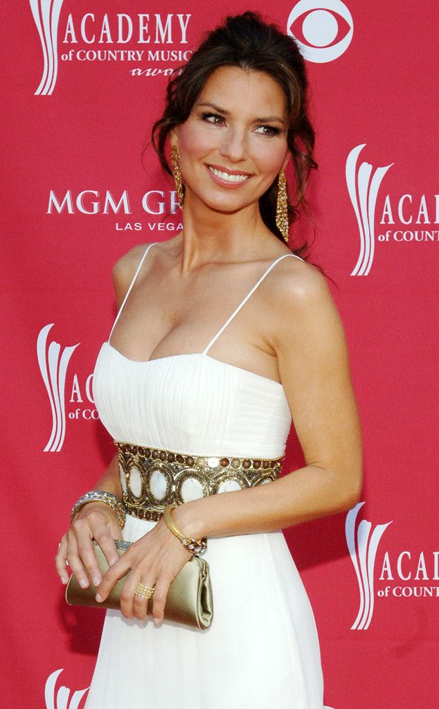 Greek Goddess from Shania Twain's Sexiest Looks  The gold belt adds a certain Greco-Roman flair to her white slip dress at the 42nd Academy of Country Music Awards in Vegas in 2007.