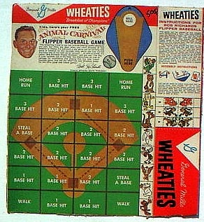 """General Mills released this simple """"Flipper Baseball Game"""" on their Wheaties cereal box. Players flipped a cutout baseball token onto an image of the ball field to determine the result."""
