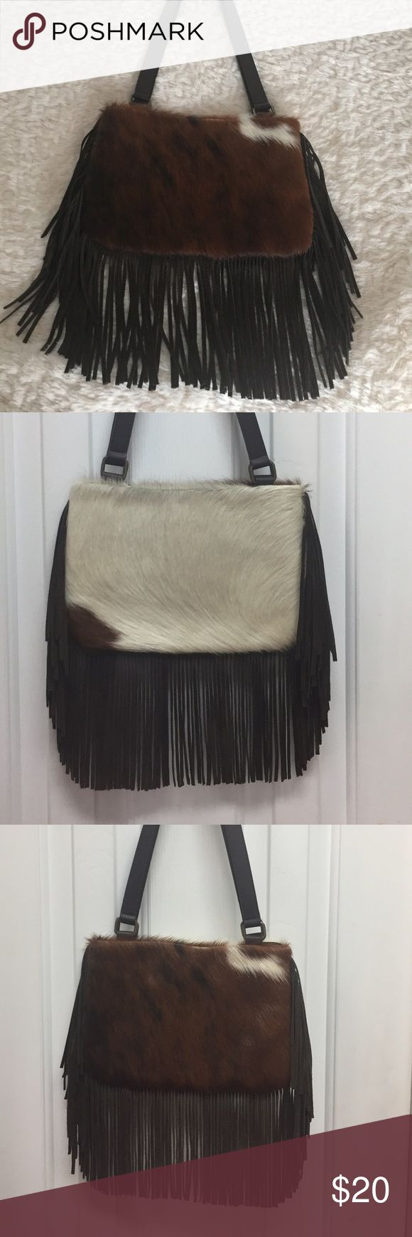 Fun & Flirty Cow Hide and Fringe Purse Bag This genuine leather cow hide fringed purse is mainly white on one side and brown and black on the other. Flirty fringe. Measures 10.5 x 7 . Zipper closure. Inside zippered pocket Nd accessory pocket.Check out other items in my closet to bundle and save. Reasonable offers accepted. Express Bags