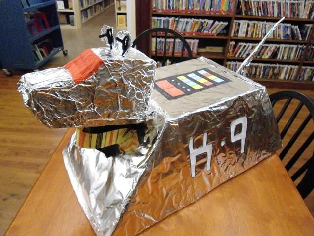 """K-9 from the BBC's """"Doctor Who"""". Made with foam board, aluminum foil, and lots of tape/love. For library's Doctor Who Party."""