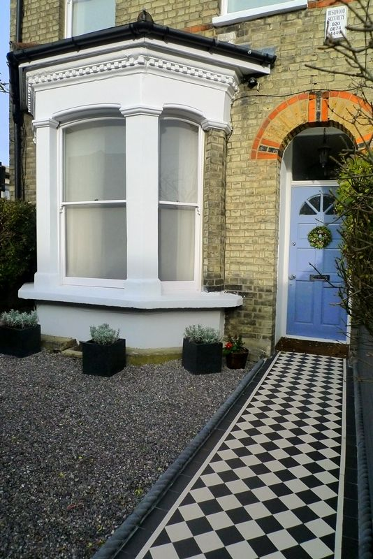 Formal front garden with Black and White Victorian style path and rope top edge tiles with Limestone chippings and Lavendar in black resin planters