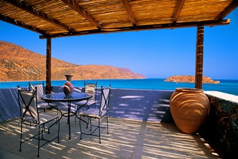 Blue Palace Resort & Spa, Elounda. Overlooking cerulean waters and featuring 142 private pools, the resort elegantly blends Greek culture with outstanding service and grace.